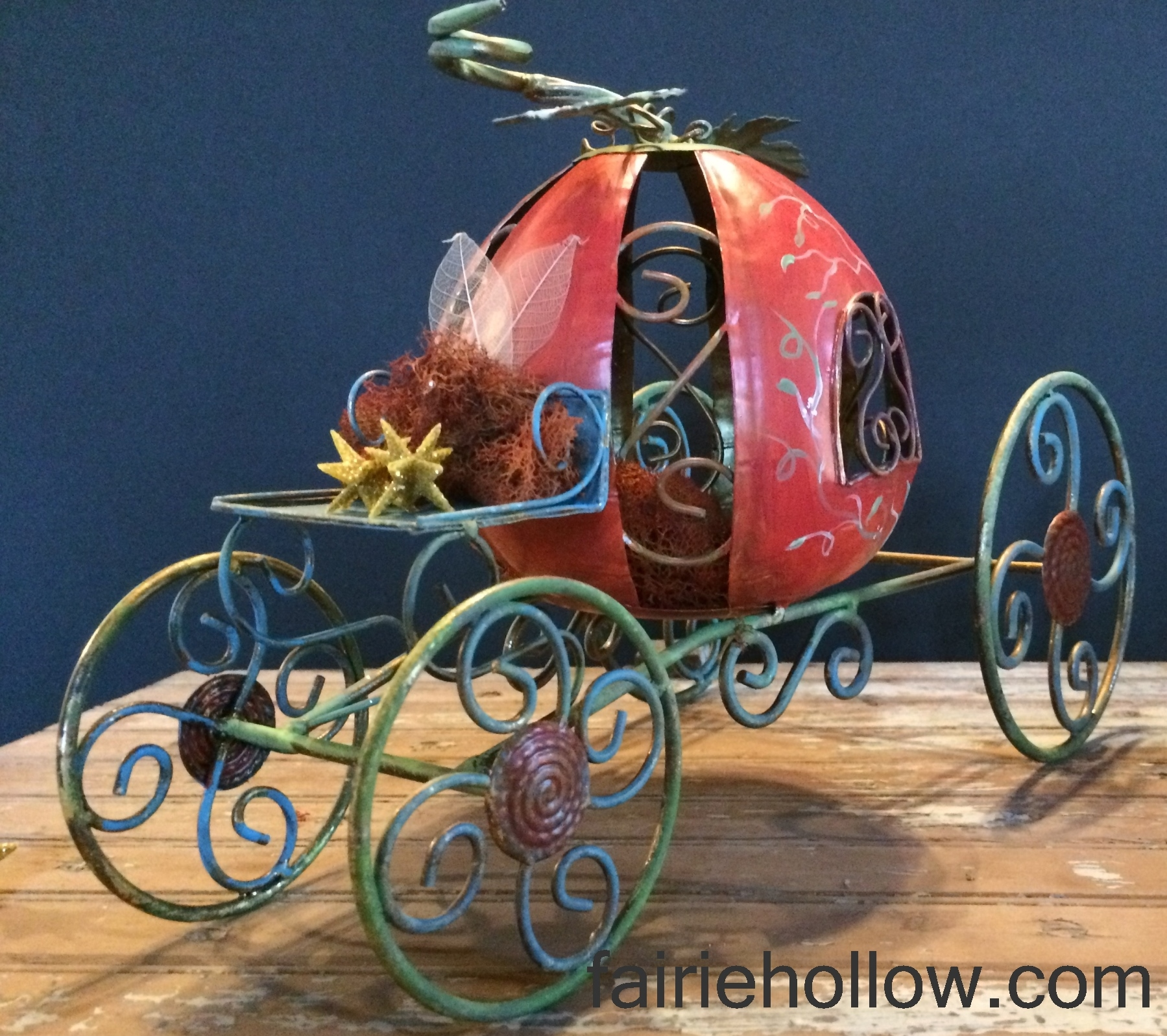 enchanted metal fairy pumpkin-carriage painted orange and green with vines