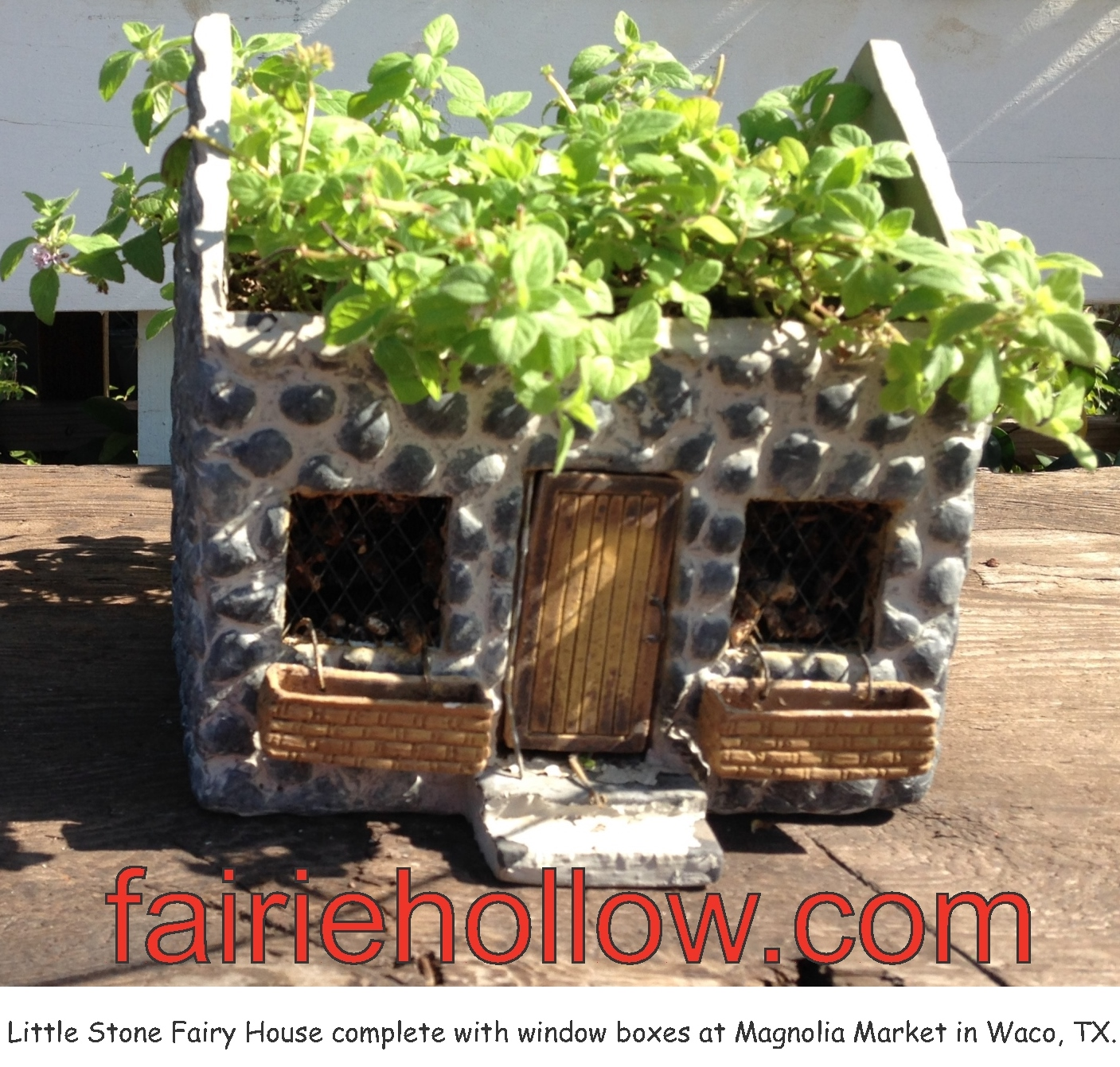 At Magnolia-Market in Waco, Texas, in their fairy garden was a stone fairy house with a planted roof | fairiehollow.com