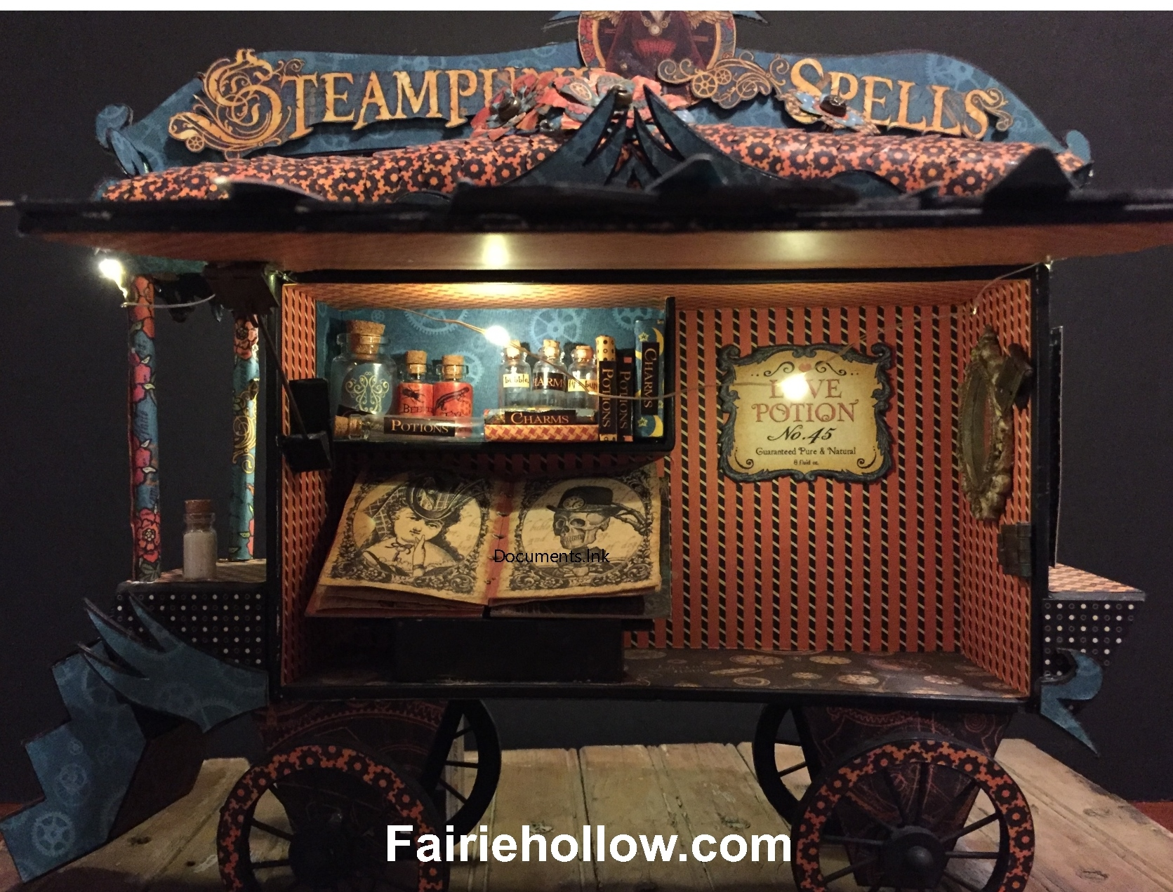 This fairies steampunk caravan is made from a cigar box and covered with papers from Graphic 45. fairiehollow.com