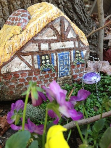 painted fairy house on rock