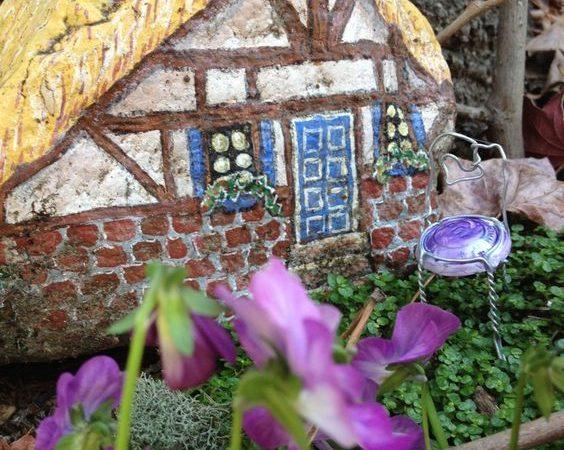 painted fairy house on rock   fairiehollow.com