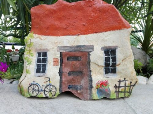 painted rock fairy house with bike