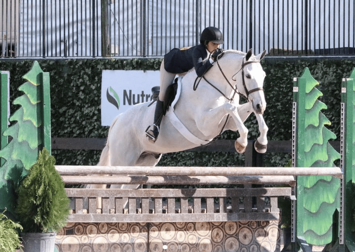 Raina and Most Likely in the 3'3 Junior Younger Hunters in Wellington, FL