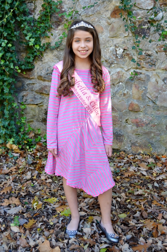 Madison is wearing the Pink-A-Boo dress, style 8303PK, available in size 4-10.