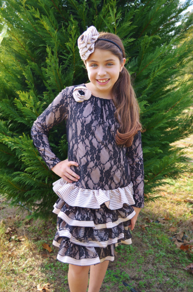 Madison is wearing our Almond Truffle dress, style 8376BK, which is available in sizes 2T-14.