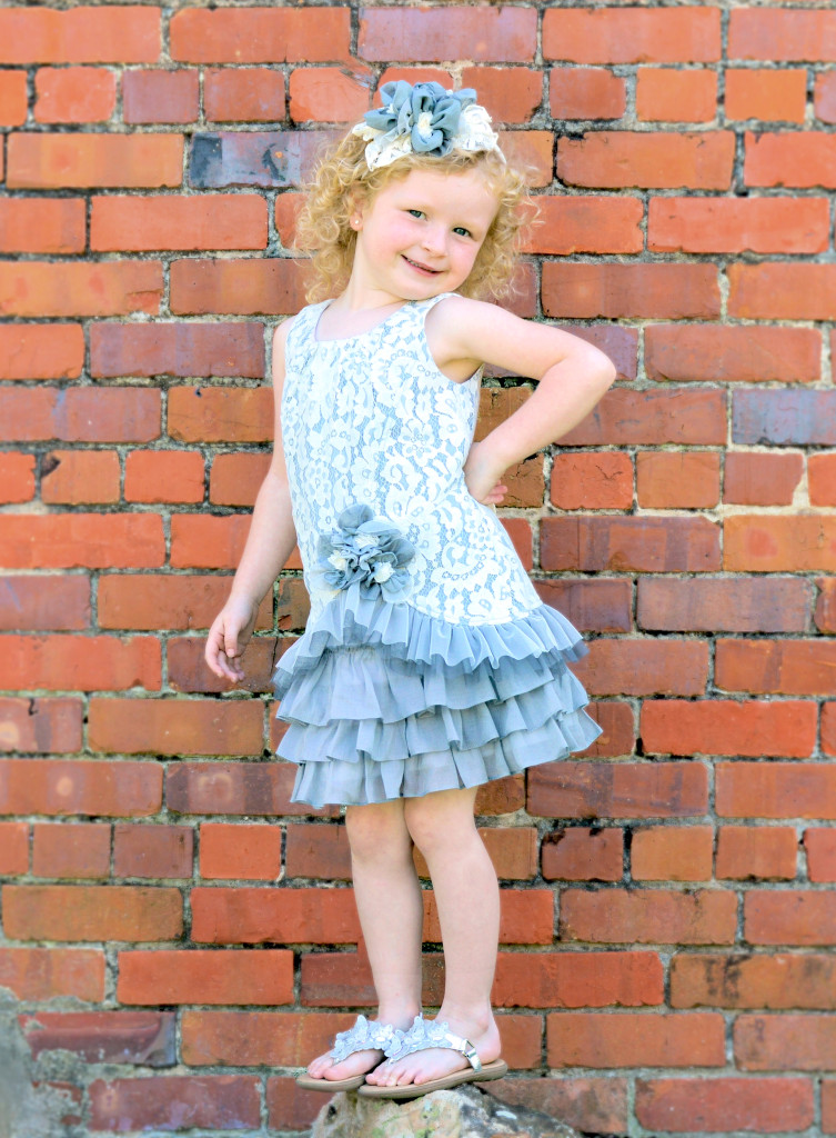 AnnaLane is wearing Countryside Doll, available in stores now in sizes 2T-16.