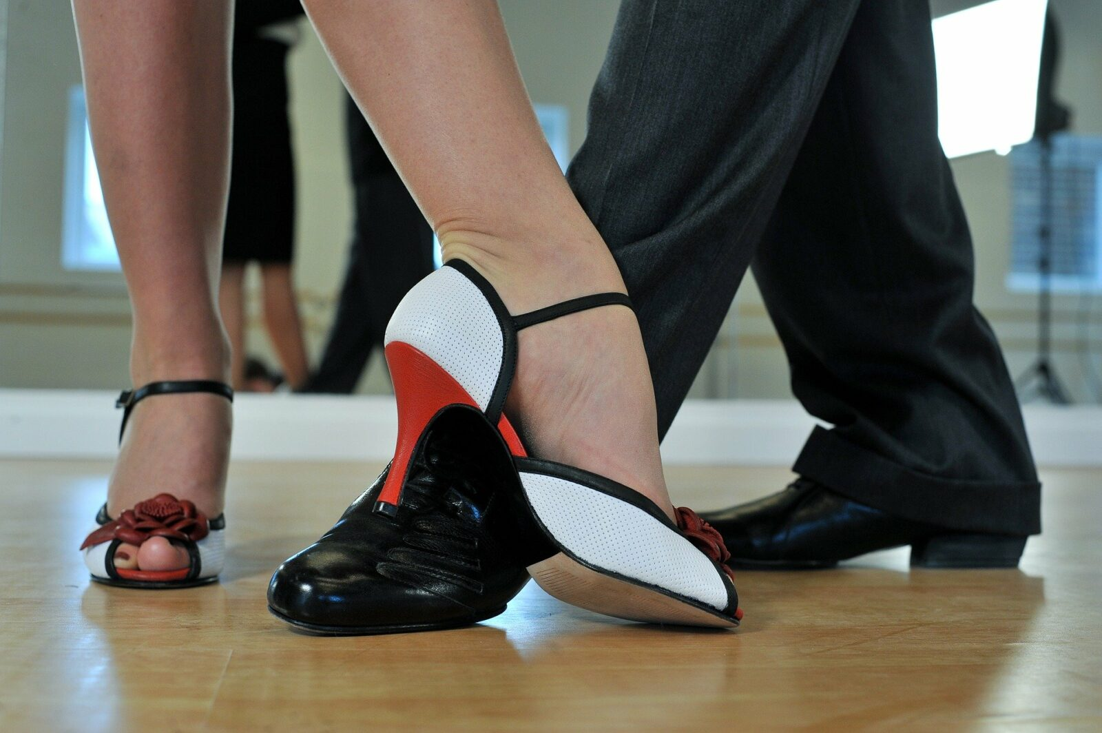 close up of man and woman's dancing feet in dress shoes