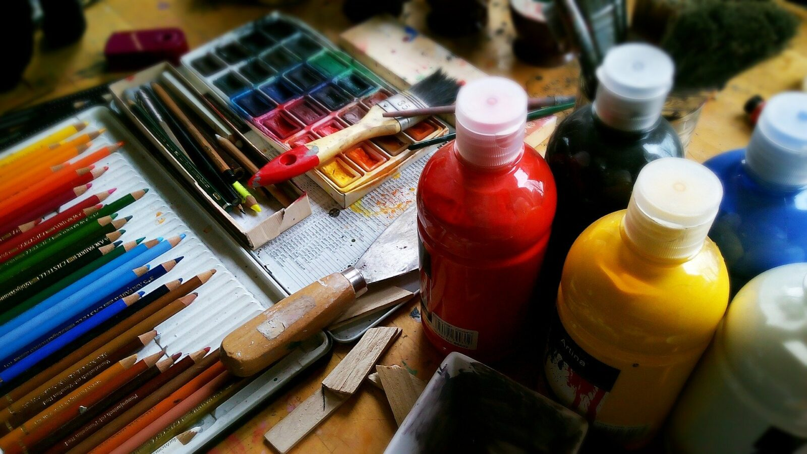 Pencils, paints and brushes