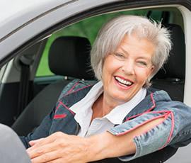 senior female in a car smiling