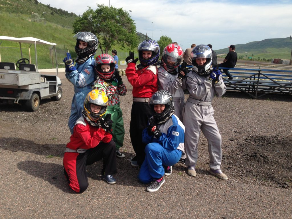 teens dressed in go kart uniforms