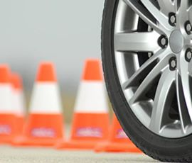 A wheel with cones in the background