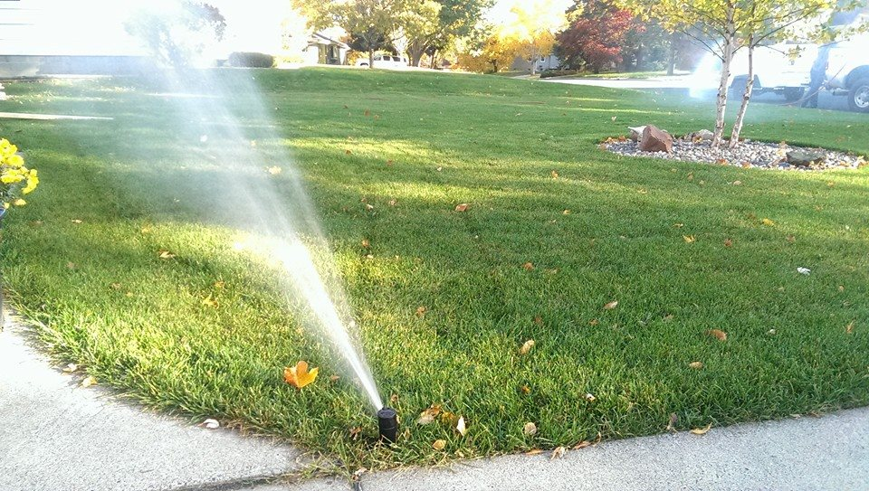 blowing out a sprinkler system
