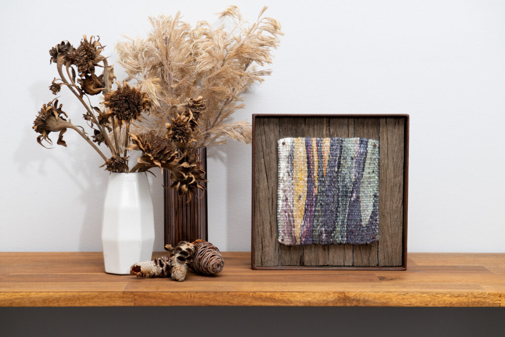 A styled image of a framed small format tapestry from the Specere collection