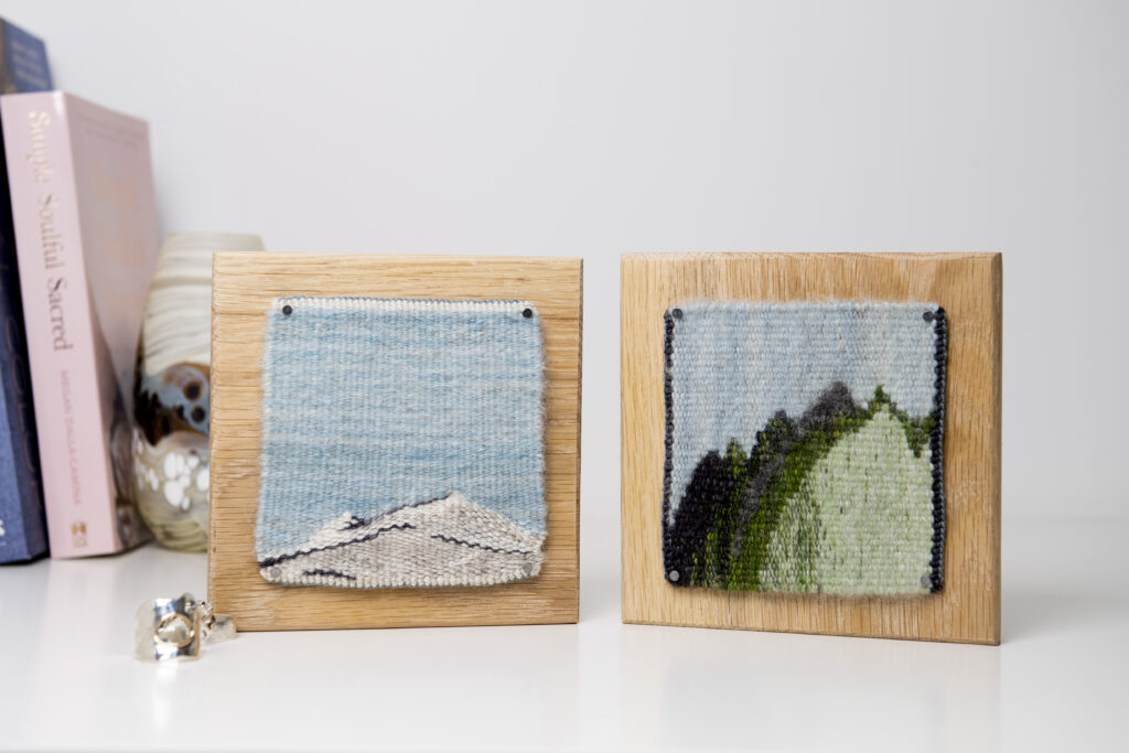 Two winter tapestries sit side by side