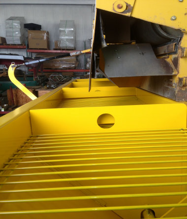 image of chip spreader hopper grizzly screens