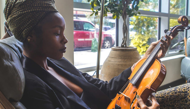 Woman with violin. Three Tips for Living Mindfully