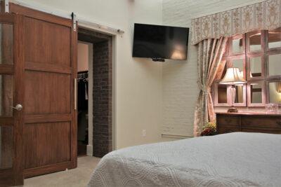 Updated condo with exposed brick and slider door