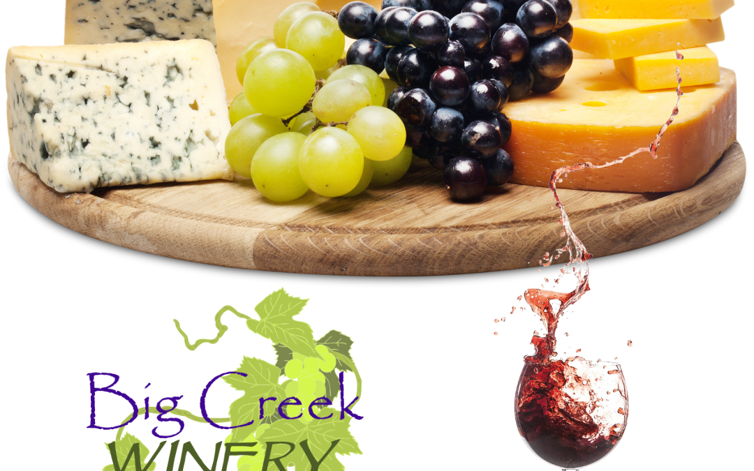 Tray of cheeses with wine glass and Big Creek Winery logo