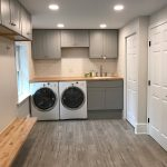 Ott-Construction-Montgomery-County-PA--Wynnewood-Interior-Projects-Custom-laundry-room-radiant-heat-floor-pocket-door-butcher-block-bench-seat-wood-porcelain-floor-white-subway-tile-built-in-sink