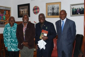 "From left to right after presenting the book: ""Satisfying Zambian Hunger for Culture"" to President Kaunda; Mr. Mfula, Dr. Tembo, President Kaunda, and Mr. J. J. Mayovu."