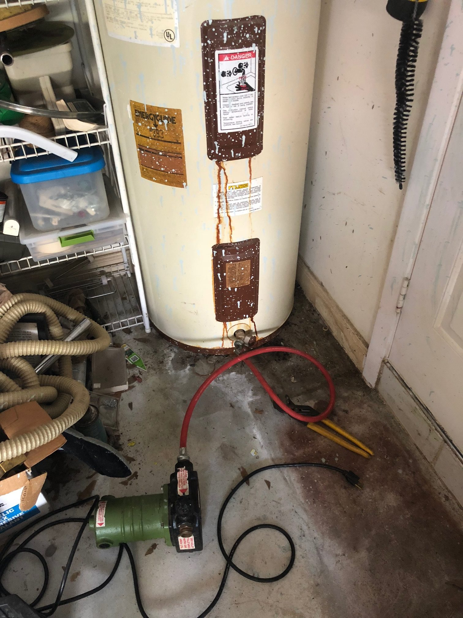 draining old water heater with a pump and hose