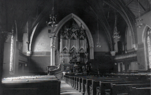 "A photograph of the Lucas and Garrison Church ""audience-room."""