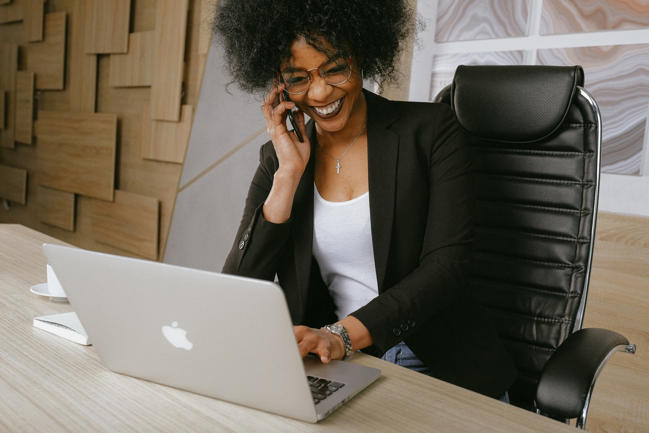 Woman enjoying 2021 business phone systems