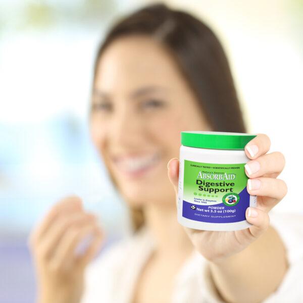 AbsorbAid Original 100g Digestive Enzyme Powder woman holding