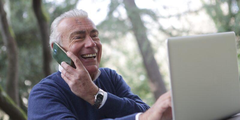senior citizen on telephone