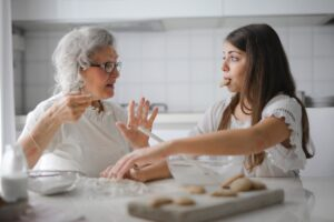 aide making cookies with patient