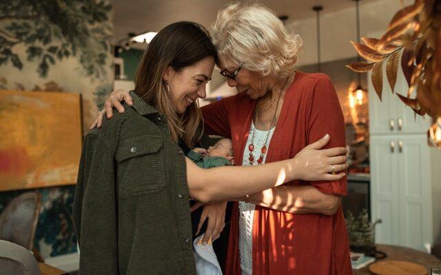 grandma hugging daughter