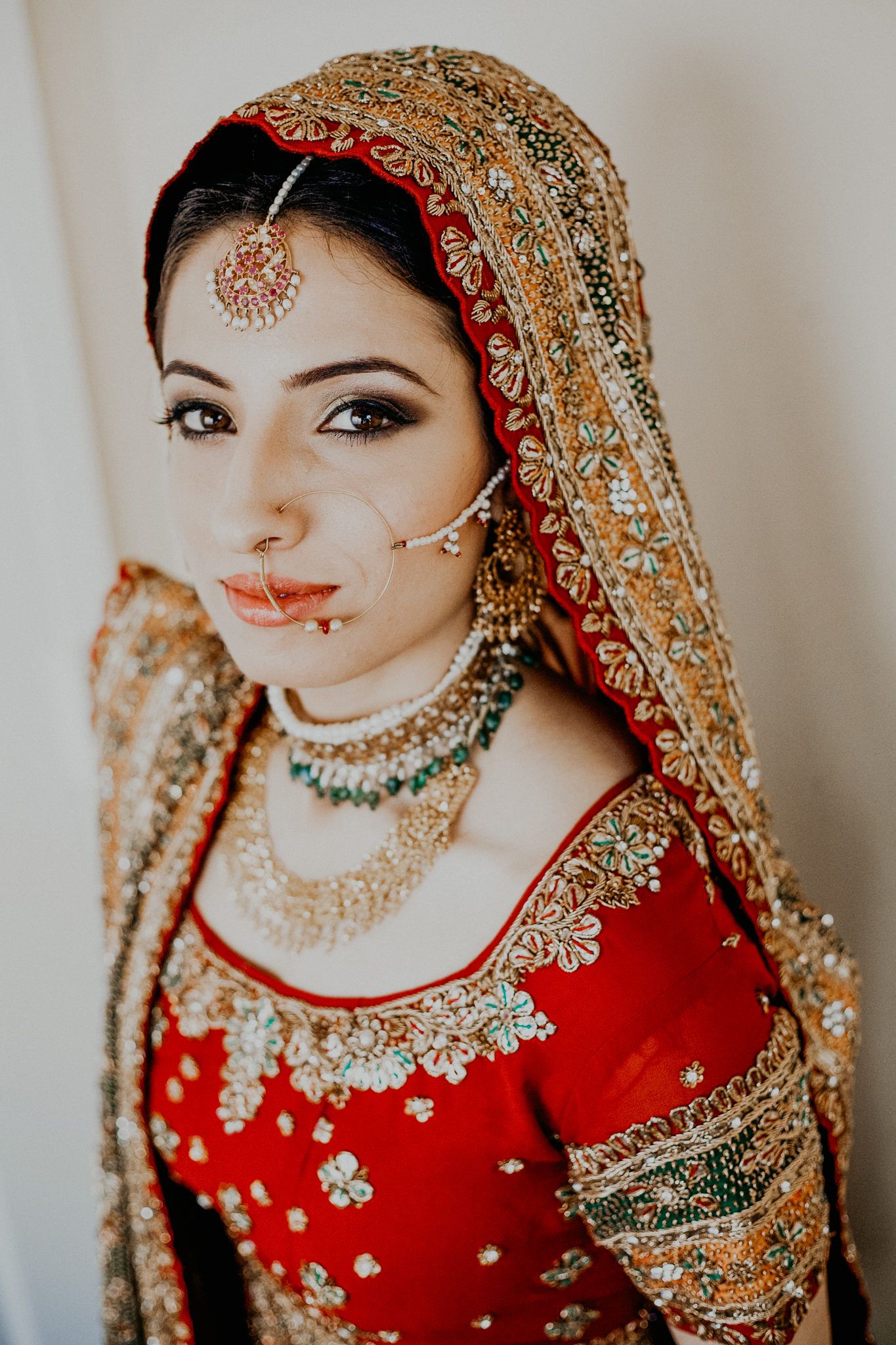 Portrait of Indian bride in red and gold dress