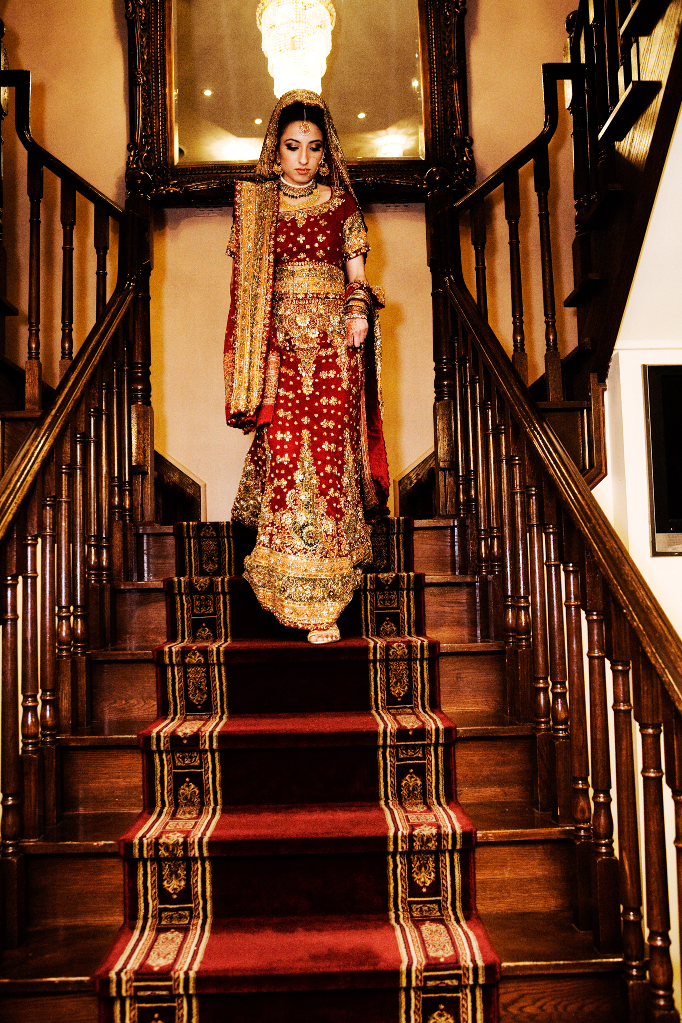 Mehndi bride on stairs Muslim wedding MN documentary wedding photographer