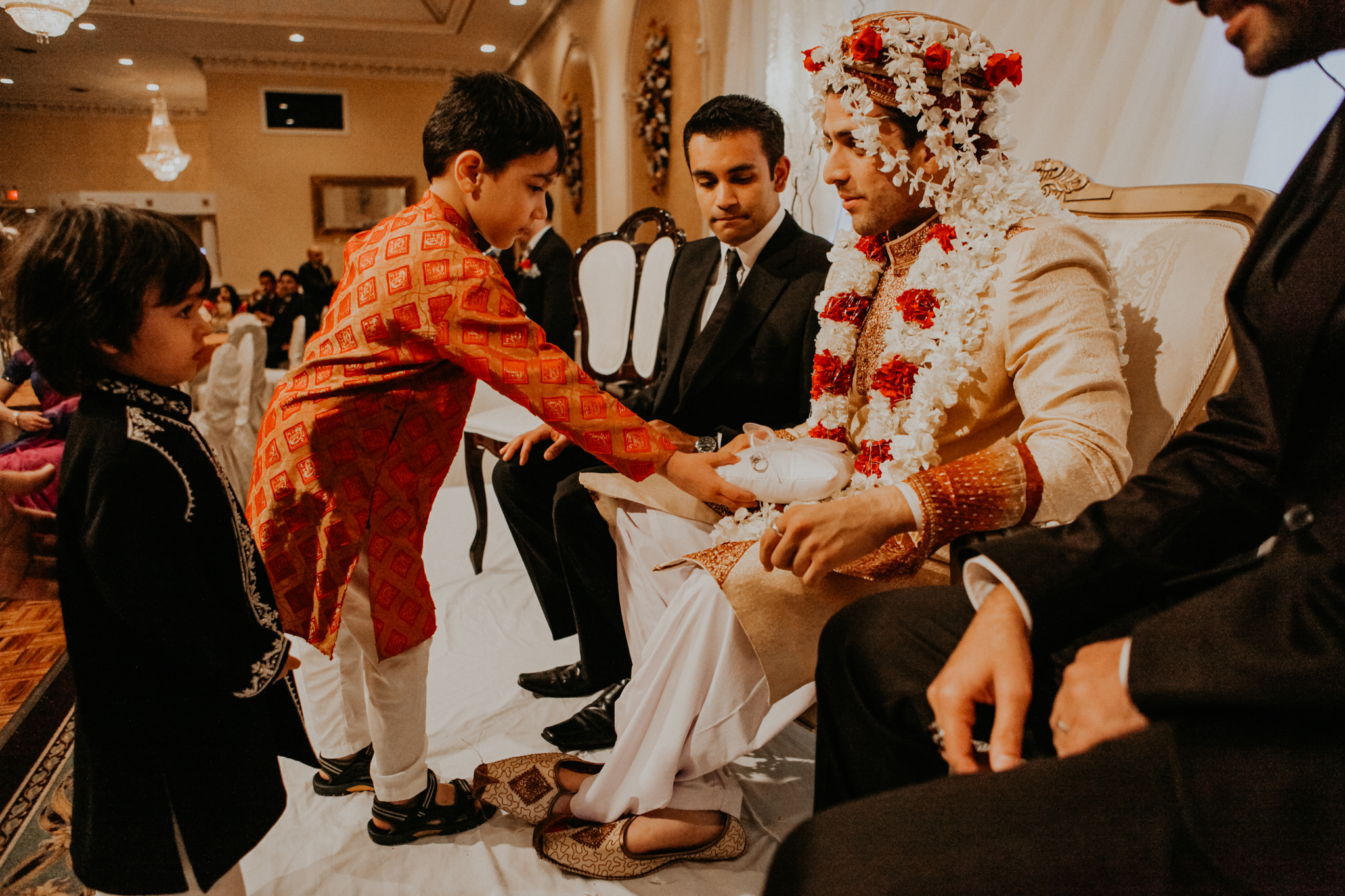 Ring bearer brings rings to groom at Mehndi