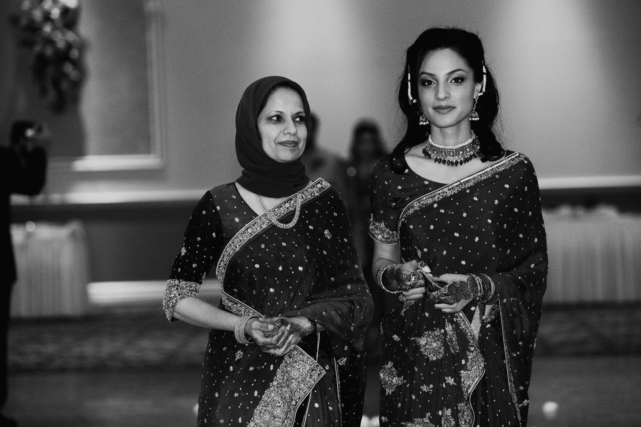 Mother and sister of bride at Mehndi wedding