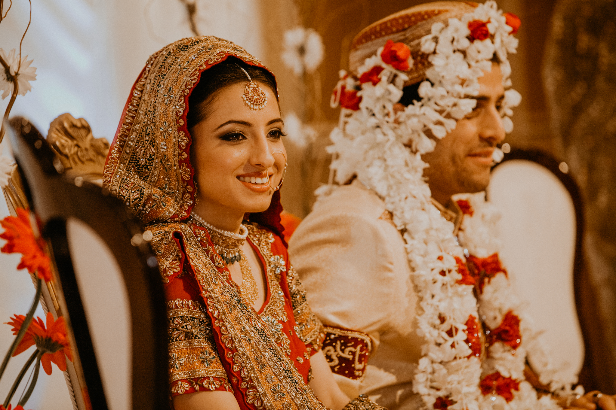 Indian bride and groom listen to speeches at Indian Mehndi wedding MN documentary photographer