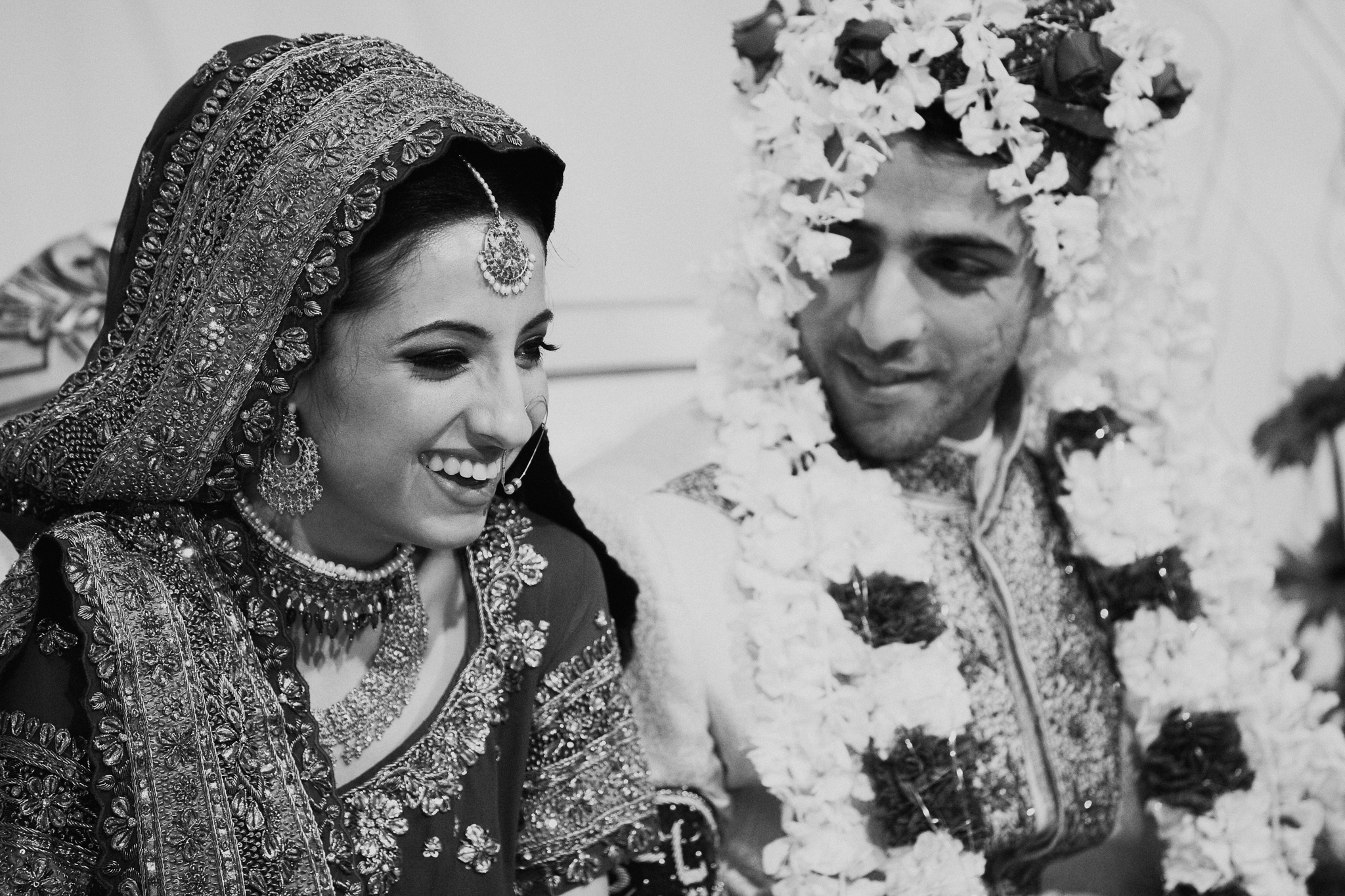 Indian bride and groom laugh during speeches at Indian Mehndi wedding MN documentary photographer