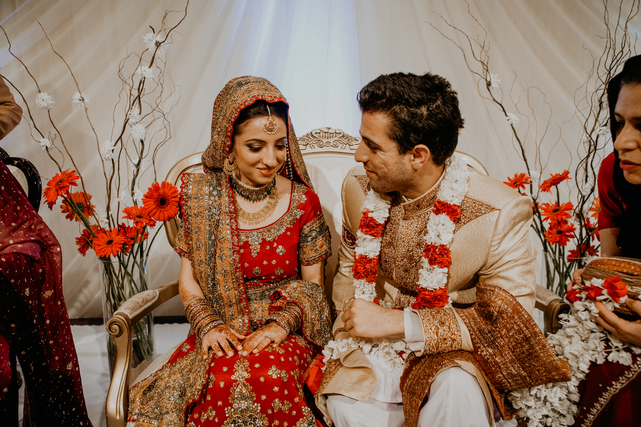 Bride and groom exchange rings at Mehndi ceremony Indian wedding photograph Minneapolis MN
