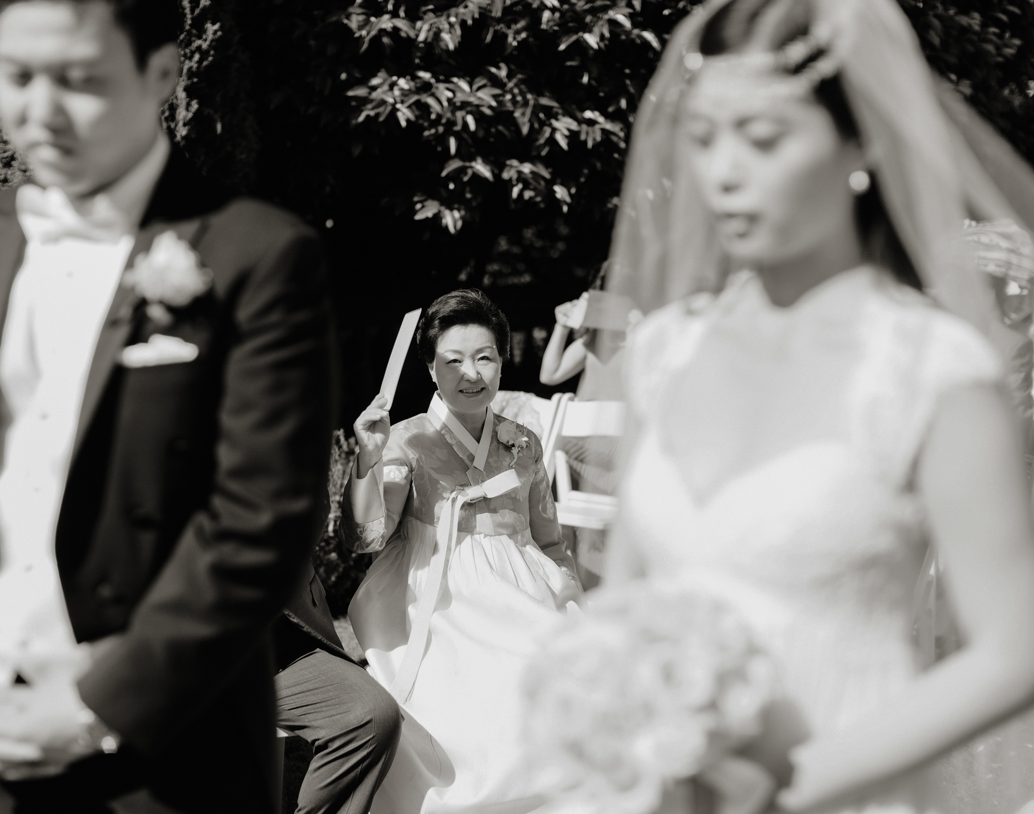 Mother watches bride and groom exchange vows in Korean wedding ceremony