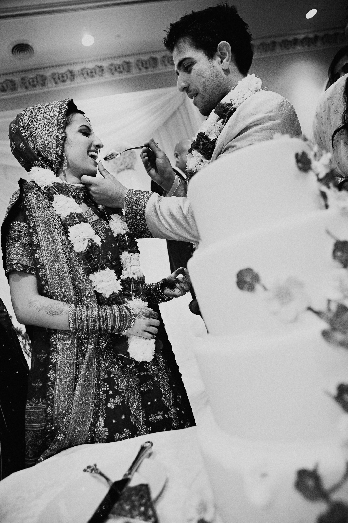 Bride and groom each cake at Mehndi Indian Islamic wedding MN documentary photograph