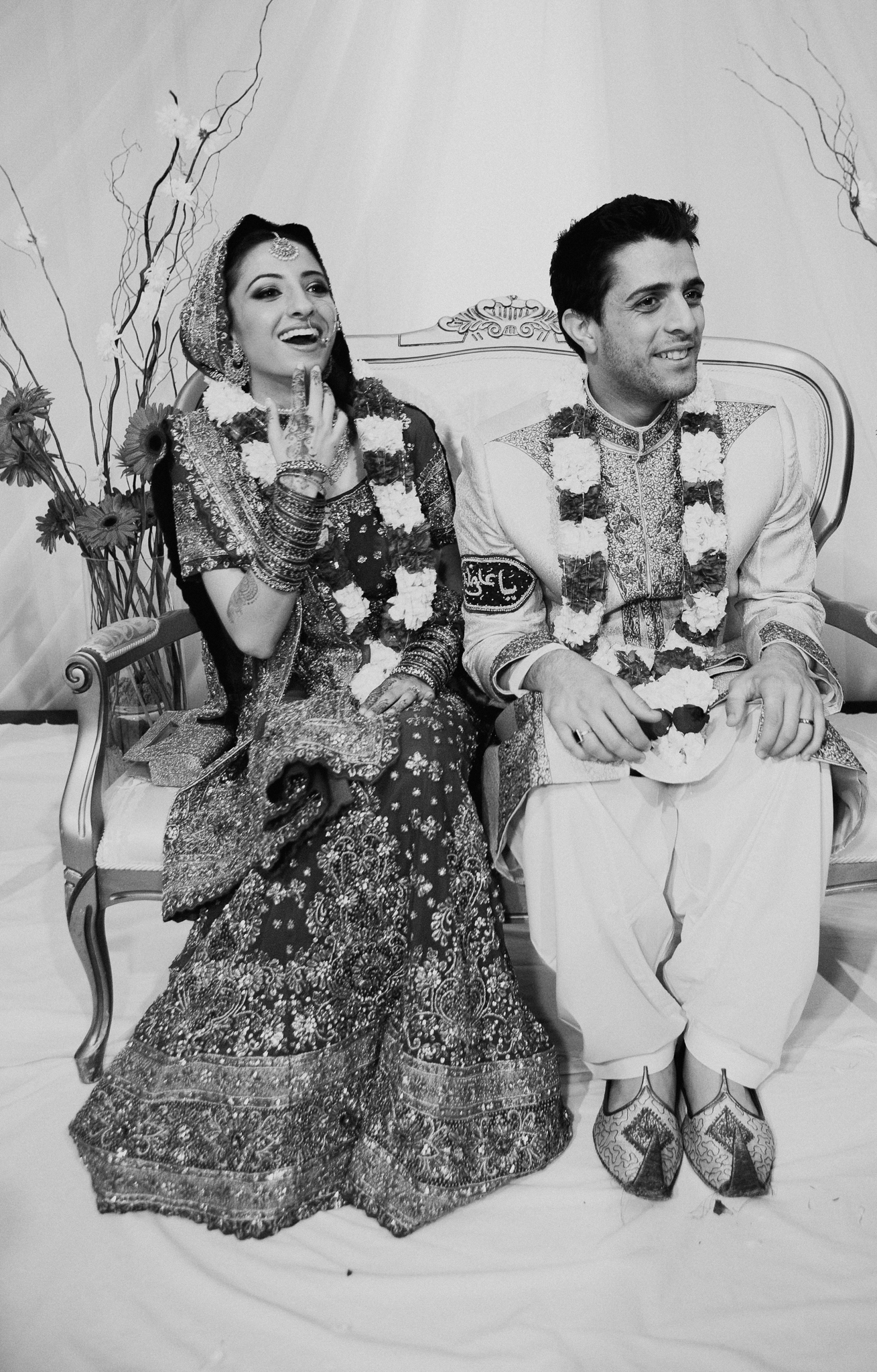 Bride and groom smile at Mehndi wedding celebration