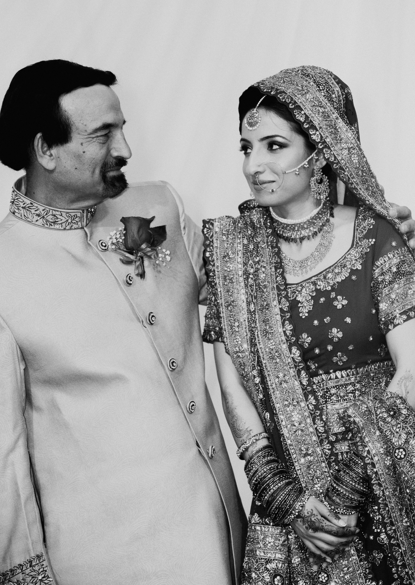 Candid portrait of father and bride at Mehndi Indian wedding