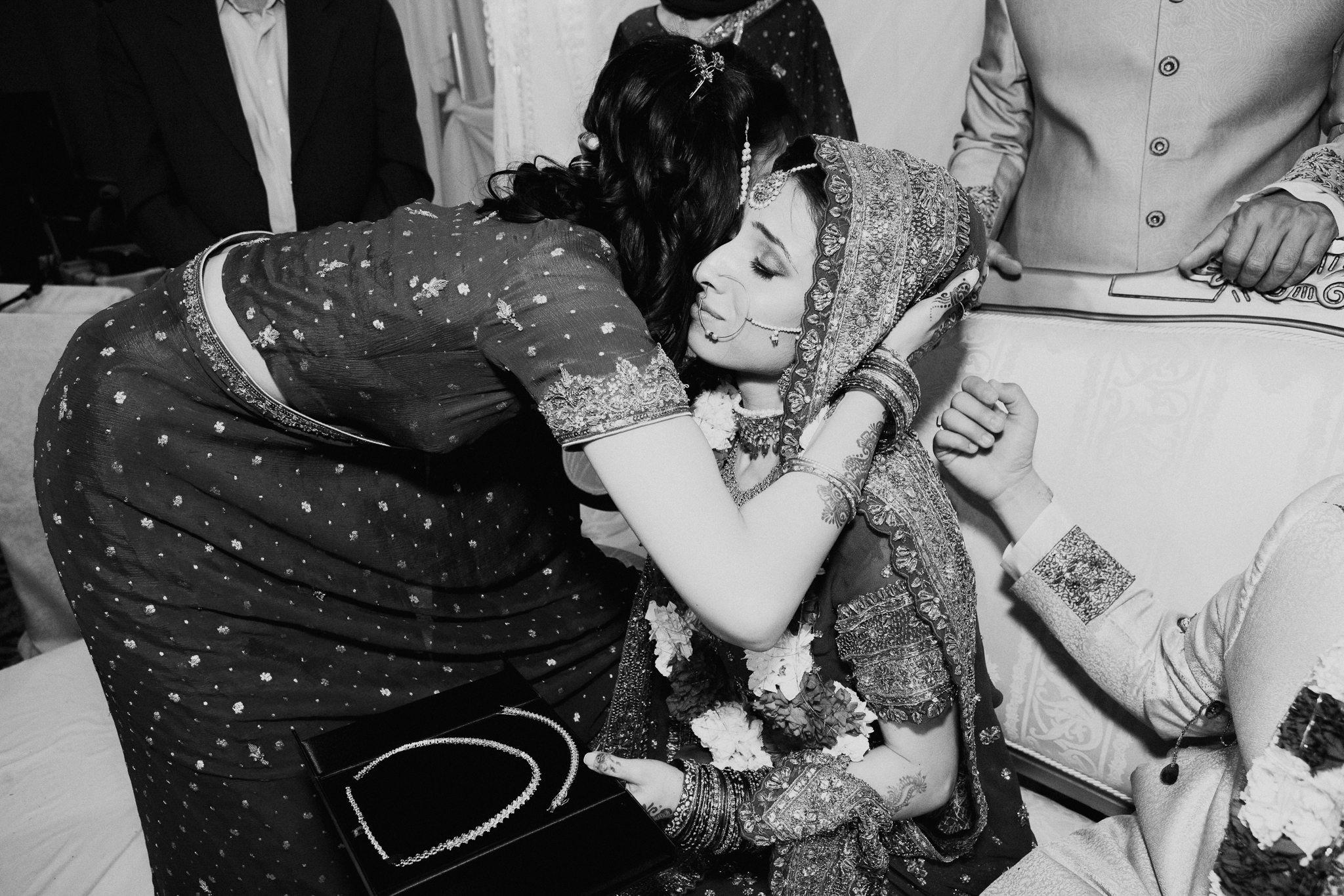 Sister hugs bride during Mehndi Indian wedding MN documentary wedding photo