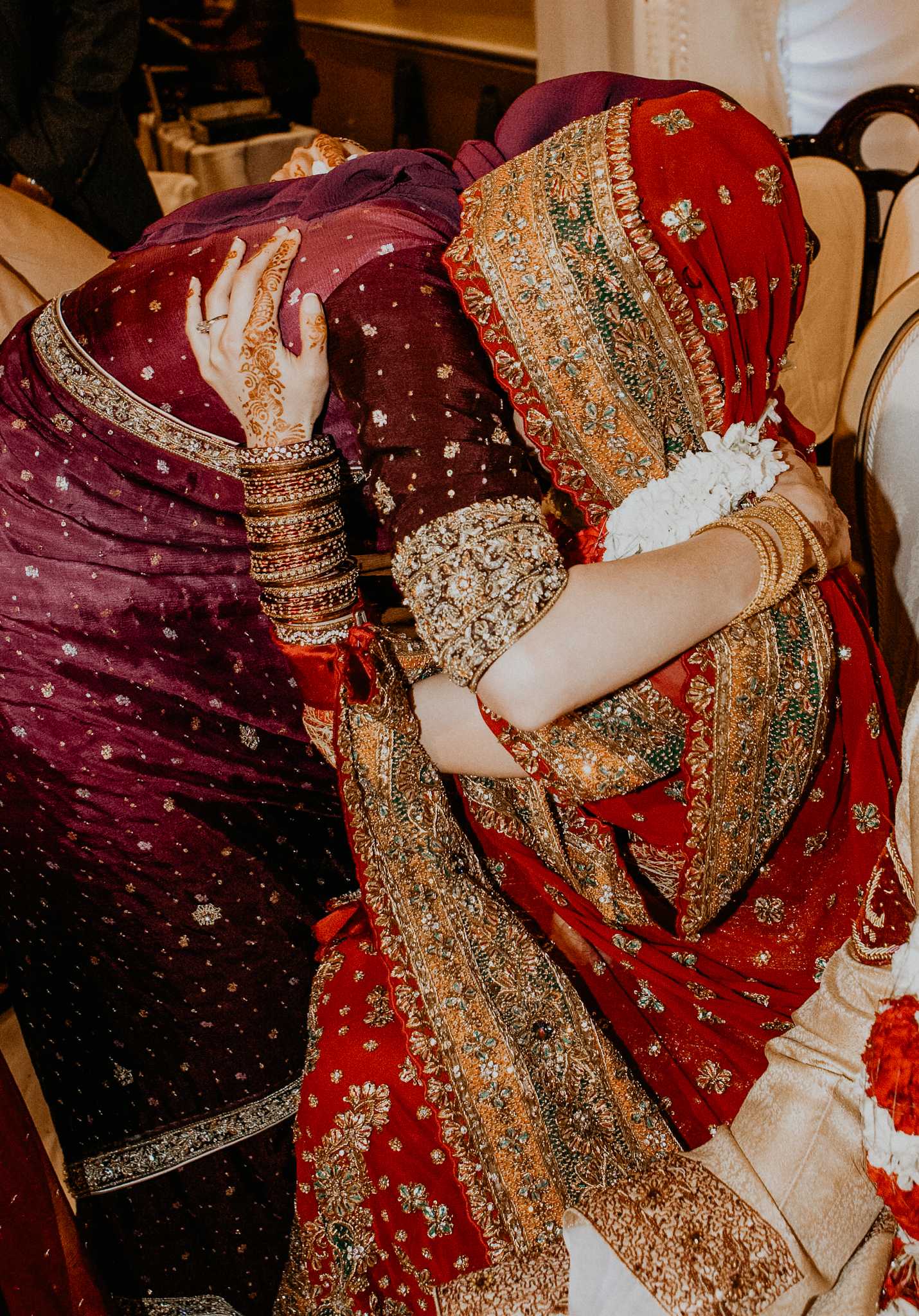 Sister hugs bride at Indian wedding MN Indian wedding photo