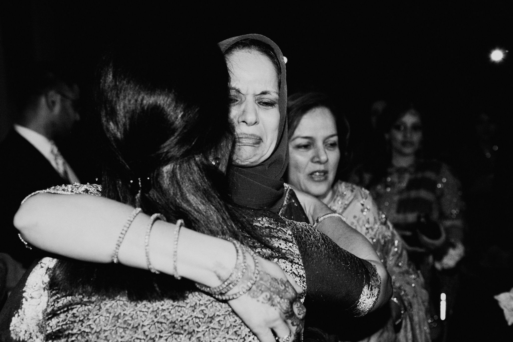 Mother of bride cries with women at Islamic Muslim Nikah ceremony documentary photo Minnapolis