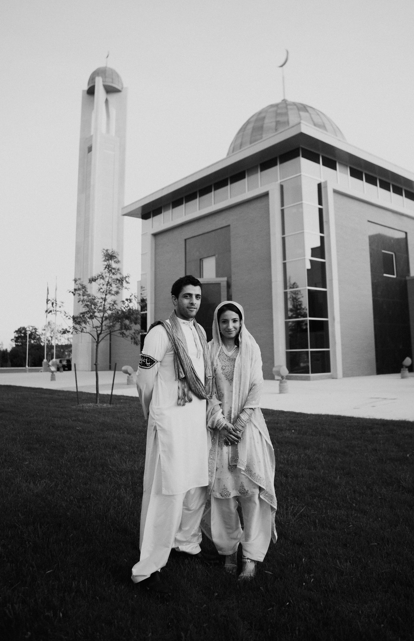 Bride and groom portrait outside Islamic temple at Indian wedding