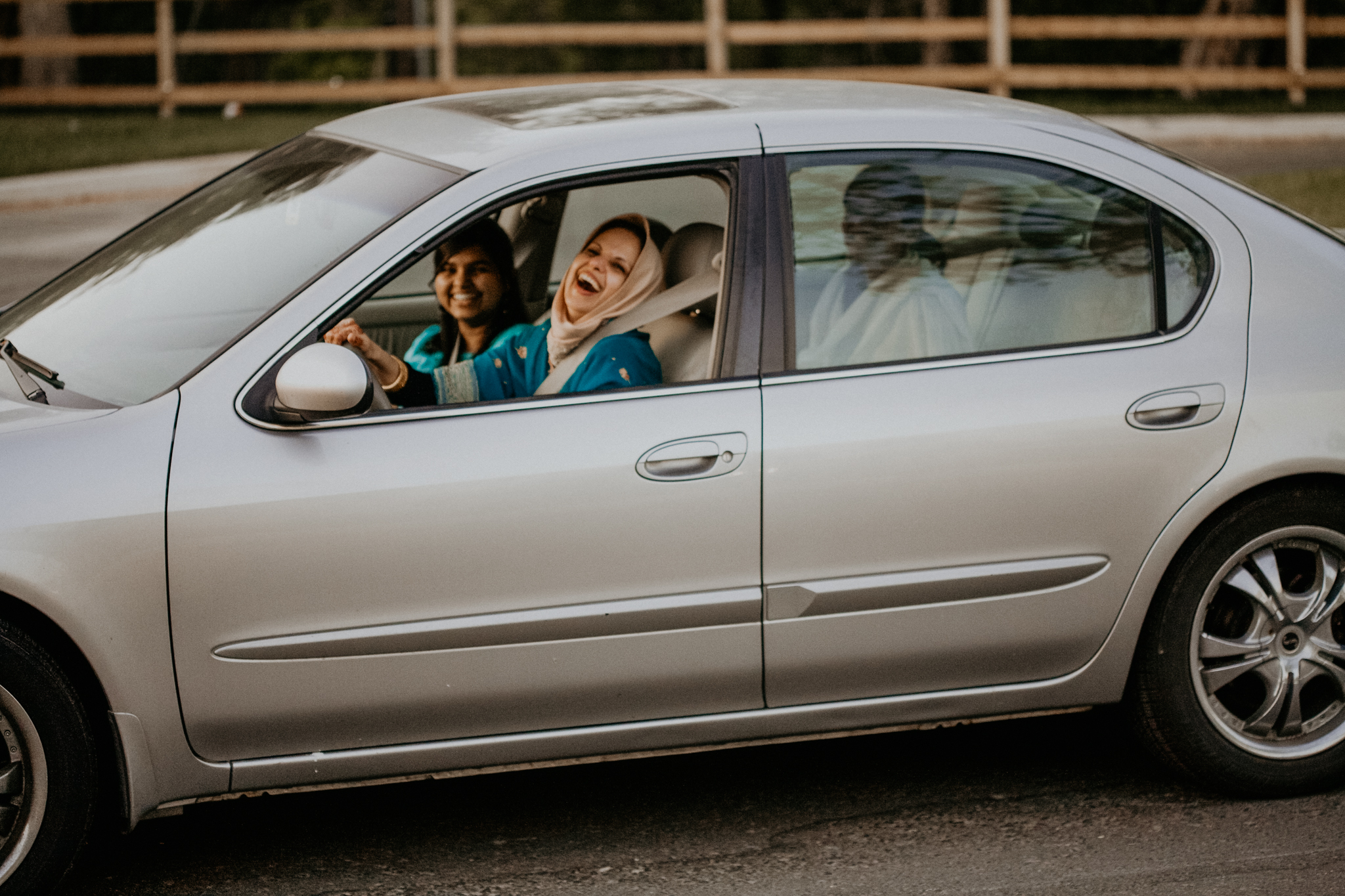 Candid photo of mother of bride arriving in car to ceremony