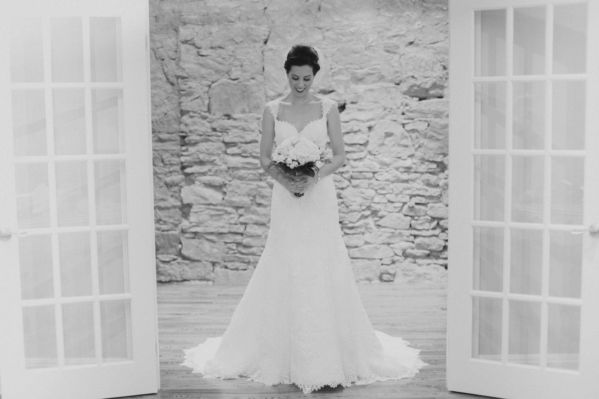 Portrait of bride in wedding dress framed by doorway