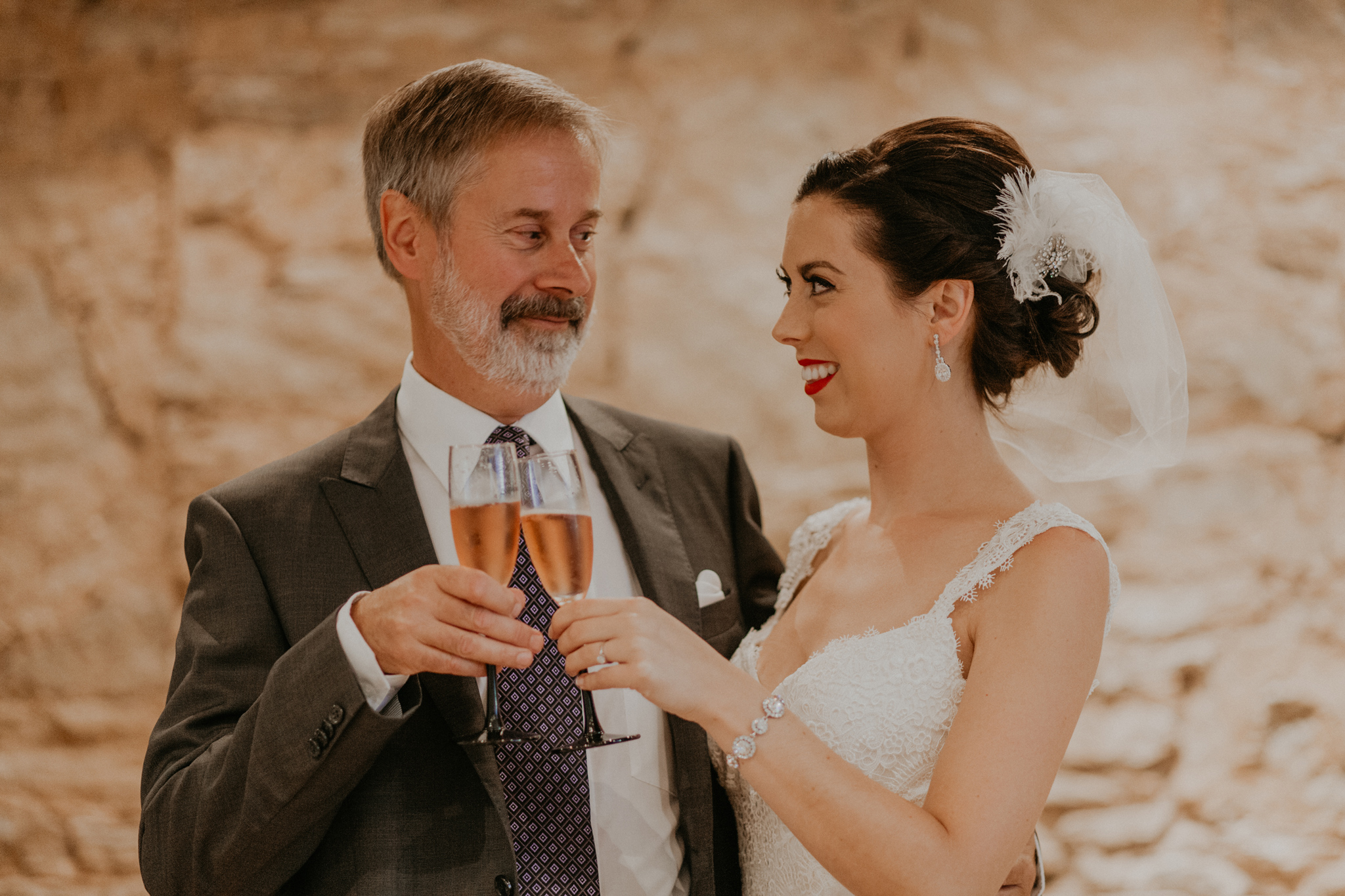 Father of the bride toasts bride during getting ready pictures