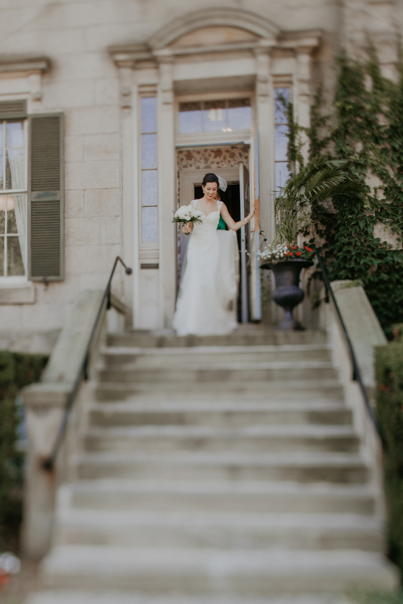 Bride walking down steps with bridesmaid on wedding day